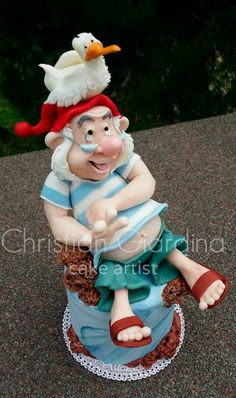 Mr Smee and his seagull! One of the funniest characters from Disney's Peter Pan! Totally handmade with Sugarpaste!