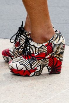 1700  Really a crazy shoe. It looks old-ladyish but the print is actually really cool and grannies don't usually wear platforms. Strange.