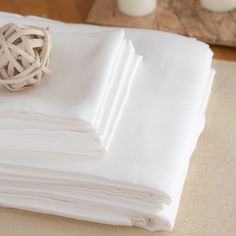 white silk sheets (plus faqs about silk charmeuse and bedding)