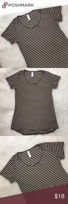 💖Final Drop💖LuLaRoe Classic T Stripes Size XXS Gorgeous Black and Cream LuLaRoe Classic T Top. Cute with Jeans, leggings or just knotted with a pencil skirt. Fits up to Size 4. Pre loved in great condition!. Made of 51% rayon, 47% polyester and 2% spandex. LuLaRoe Tops Tunics