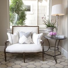 Im just in complete love with this entry ! from the tile to the settee to the accent table , pillows , window , table accessories ect ! well done .