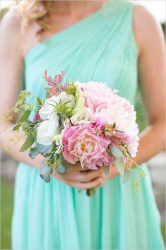 teal bridesmaid dress and pink and white bouquet #tealbridesmaiddress #malibuwedding #weddingchicks http://www.weddingchicks.com/2014/01/06/coast-to-coast-wedding/