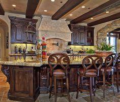 Dark wood, ornate corbels, and ceiling beams