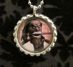 Items similar to Trilogy Of Terror Zuni Fetish Warrior Doll Bottle Cap Necklace or Keychain (TOT 101) on Etsy