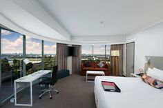 The aptly named Panorama Suite at Parramatta features the best views in the hotel. Penthouses, Nice View, Conference Room, Table, Furniture, Home Decor, Mulches, Decoration Home, Room Decor