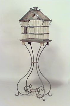 American Victorian style blue painted metal bird cage with iron scroll base and perforated roof