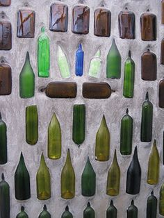 Shower Bottle Wall. I need to find out what technique was used to build this....Funky and Fun!