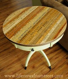 Replace a damaged veneer table top with vintage old wooden rulers. Upcycle, recycle, salvage, repurpose! For ideaqs and goods shop at Estate ReSale & ReDesign, Bonita Springs, FL