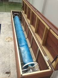Just wondering if anyone has seen any nifty solutions for hiding a pool cover and roller. I'm thinking maybe we could have something like a timber box near the end of the pool with a hinged lid so it could double as a seat? Swimming Pool Landscaping, Pool Fence, Swimming Pools Backyard, Retractable Pool Cover, Solar Pool Cover, Pool Equipment Enclosure, Solar Blanket For Pool, Pool Cover Roller, Piscine Diy