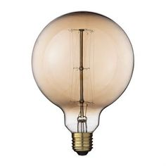 Accent your lamp with a retro feel and infuse your room with a soft amber glow when you install this round globe light bulb. Round Light Bulbs, Old Lamps, Amber Color, Colored Glass, Vintage Looks, Glow, Interior Design, Lighting, House Styles