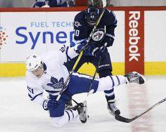JOHN WOODS / THE CANADIAN PRESS</p><P>Winnipeg Jets' Joel Armia (40) checks Toronto Maple Leafs' Jake Gardiner (51) during first period NHL action in Winnipeg on Wednesday, October 19, 2016.