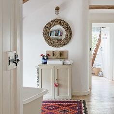 White country bathroom with red Aztec rug