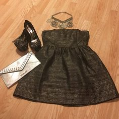 silver and black strapless metallic dress. New dress size large. Silver and black woven strapless metallic  party dress.  Size large. 89%polyester 5% metallic yarn 4% cotton 2% rayon. RUSH Dresses