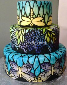 Stained Stain Glass Cake - Tiffany - Fondant covered cake hand painted with food coloring. Dragonflies, butterflies & grapes.  Holly Lenard.
