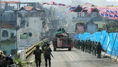 """The Philippines military is about to end the long battle of Marawi where an Islamic State-linked terrorist group is making its """"last stand"""" amid heavy fighting, top army commanders announced, according to AFP. Philippine Army, Philippine News, Last Stand, Latest World News, City Streets, Troops, 21st Century, Philippines, Battle"""