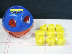 Tupperware toy - want for future kids.  I had one but couldn't pronounce my 'r's, so the diamond-like shape was 'parawewogram.'