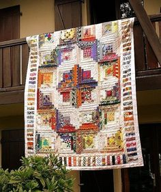 A lovely scrappy Log Cabin quilt. Want to make one with my scraps like this...