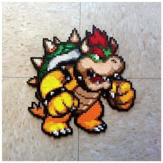 A perler plate of Bowser from super mario bros. Sprite made by He was my first watcher so I made this as a thank you. Pearler Bead Patterns, Perler Patterns, Pearler Beads, Fuse Beads, Pixel Art, Hama Beads Mario, Yoshi, Hama Art, Mtg Altered Art