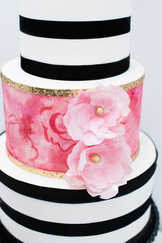 Pink, black, and white cake. Cityview Bakehouse. Photography: Rachel Peters Photography - www.iamrachelpeters.com  Read More: http://www.stylemepretty.com/canada-weddings/2014/06/09/modern-stripes-florals-wedding-inspiration/