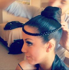 High bun with braided circlet. Good hairstyle for latin. Visit http://ballroomguide.com/comp/hair_make_up.html for more hair and makeup info