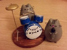 Pusheen joins a rock band as drummer. Pusheen has rhythm!