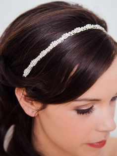 With just the right amount of bedazzle, this rhinestone bridal hairband ($46) pairs perfectly with or without a veil.  // Affordable Bridal Hair Accessories