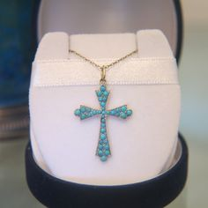 Victorian turquoise and fourteen karat yellow gold cross pendant with 14k chain
