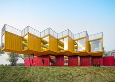 Stacked shipping containers form pavilion by People's Architecture Office
