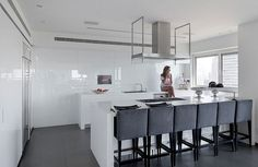 white kitchen with grey/silver details.