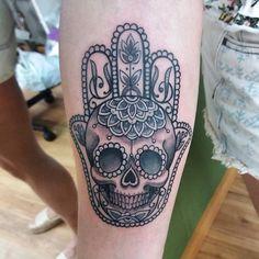 skull hamsa hand tattoos