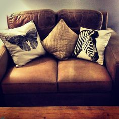 Leather sofa from eBay. Butterfly cushion from Marks & Spencer, Zebra cushion from H & M Home.