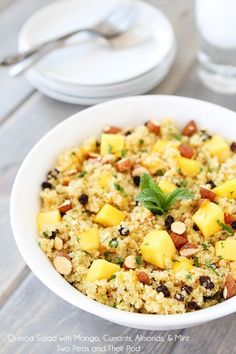 awesome Quinoa Salad with Mango, Currants, Almonds, & Mint on twopeasandtheirpo......