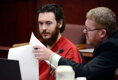 James Holmes, left, who is charged with killing 12 people inside a Colorado movie theater last July, and Daniel King, a defense attorney, appear in court in Centennial, Colo., June 4, 2013. A judge accepted Holmes's plea of not guilty by reason of insanity, setting the stage for a lengthy evaluation of his mental condition at the time of the shooting last year. (Andy Cross/Pool via The New York Times)
