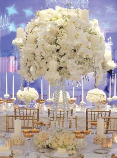 Ivanka Trump's reception had long tables set for a fairytale feast. She had three different tablescapes, each with a scented garden of all-white flowers: lilies of the valley, hydrangeas, orchids, ranunculus, roses and gardenias. The first featured white ceramic topiaries filled with lush bouquets of roses and hydrangeas. The second, small ponds with floating gardenia blossoms, and the third, a towering custom-made crystal candelabras, topped with masses of blooms and white pillar candles.