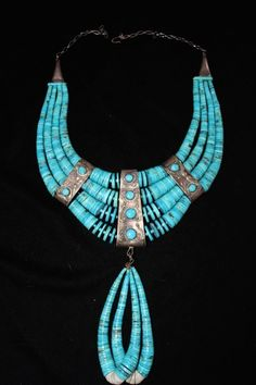 4-strand turquoise disc and silver necklace Native American necklace, circa 1940s - 50s. With attached double jacla.