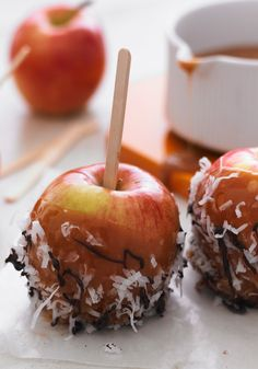 Caramel Apples with Coconut & Chocolate Drizzle -- There's nothing scary about this recipe! This fruit is topped with melted chocolate, it's perfect for a Halloween dessert table.