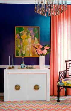 Modern + eclectic. LOVE the colors- cobalt, coral, and ochre.