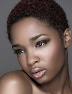 """You can never tell me Afros, Afro puffs or natural hair looks unprofessional or """"unkept."""""""