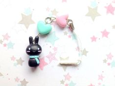 ❀ This is a winter themed cute bunny dust plug charm, decorated with colorful heart beads in pink and mint green.  ❀ The bunny is made of pvc material