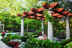 Looking for some pretty fairy tale style pergola ideas? We give you a little hand in this matter and here we have an idea came from a dreamland to allure you and your loved ones. A complete beauty package; Square shaped centered brown colored patio pergola with white colored kingly poles surrounded by beautiful flowers. Ideal for the parties and other important events to celebrate.