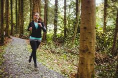 Fit brunette running in the woods