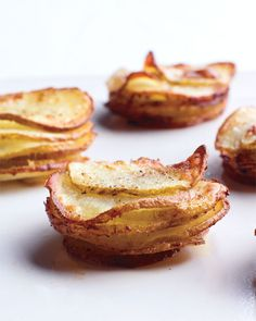 Muffin-Pan Potato Gratins  Ingredients        Unsalted butter, room temperature, for muffin cups      2 medium russet potatoes (about 3/4 pound each)      Coarse salt and ground pepper      6 tablespoons heavy cream