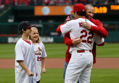 Carp hugging Matheny after blistering his hand with a 90mph fastball for the first pitch on Opening Day 2014.