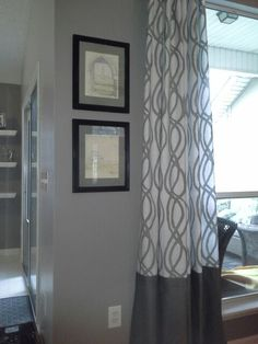 Window treatment made by adding fabric to the bottom of a shower curtain! Very thrifty!
