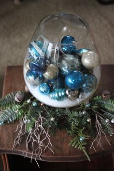 Mercury Glass balls from Poland, in blue and silver. Displayed in a large brandy snifter with faux snow