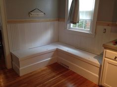 Added wainscoting and trim to wall to better define the space.