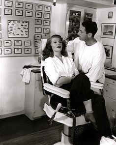 Rita Hayworth getting primped with a Hollywood makeover