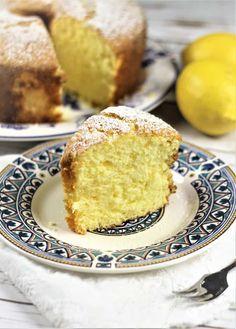 slice of Nonna's Sponge Cake with full cake in background and lemon on the side Italian Sponge Cake, Lemon Sponge Cake, Italian Cake, Sponge Cake Recipes, Italian Desserts, Italian Recipes, Italian Cookies, Italian Pastries, Almond Cakes