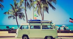 green volkswagon camper on the beach