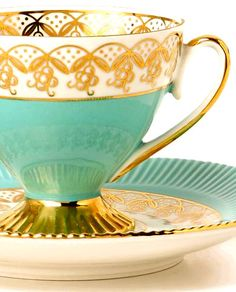 gold and turquoise teacup